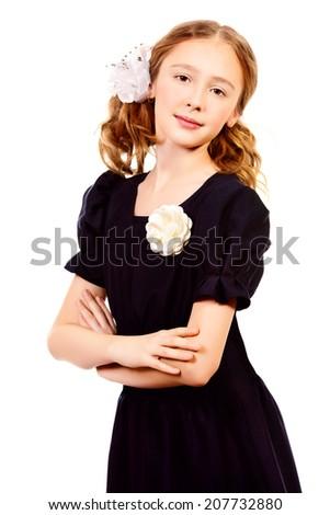 Portrait of a ten years schoolgirl wearing uniform. Isolated over white. - stock photo