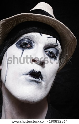 Portrait of a theatrical actor with dark makeup closeup - stock photo