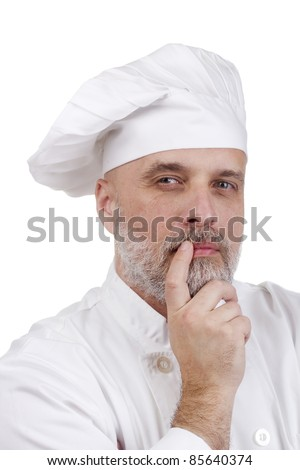 Portrait of a thinking chef on white. - stock photo