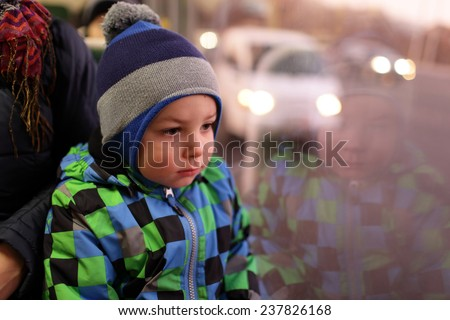 Portrait of a thinking child in a bus - stock photo