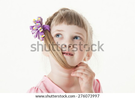 Portrait of a thinking little girl, white background