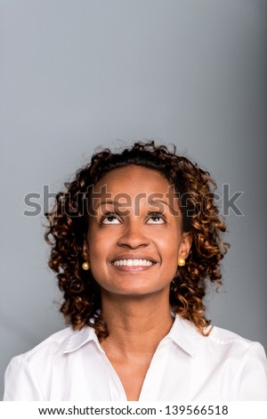 Portrait of a thoughtful African American woman looking up - stock photo