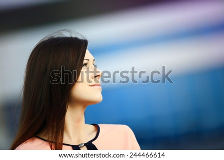 Portrait of a thoughtful businesswoman looking up outdoors - stock photo