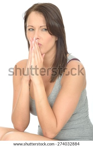 Portrait of a Thoughtful Concerned Attractive Young Woman Working out a Problem or Solution Looking Pensive - stock photo