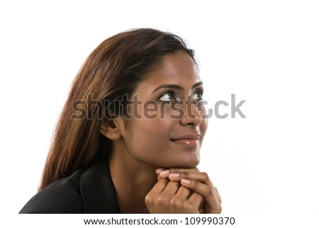 Portrait of a thoughtful Indian Business woman looking to her right. - stock photo