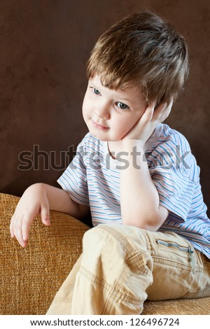 Portrait of a thoughtful little boy - stock photo