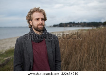 Portrait of a thoughtful looking man by the coast