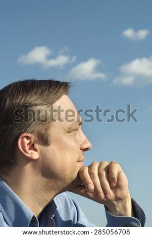 Portrait of a thoughtful man on nature