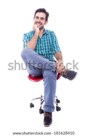 Portrait of a thoughtful man sitting on the chair, isolated on white