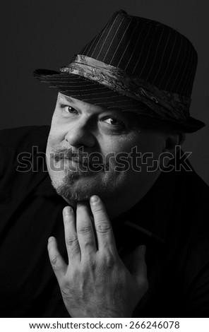 Portrait of a thoughtful mature man - stock photo