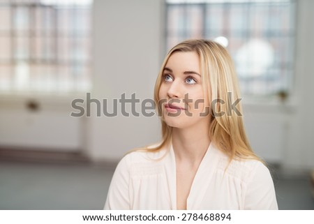 Portrait of a Thoughtful Pretty Office Woman Looking Up, Captured in Close up. - stock photo