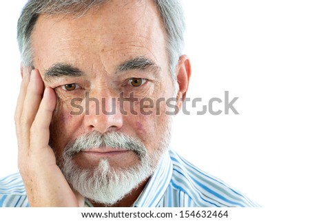 Portrait of a thoughtful senior man on white background