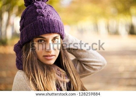 Portrait of a thoughtful woman in autumn