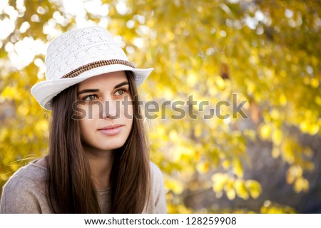 Portrait of a thoughtful woman in autumn - stock photo