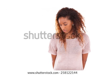 Portrait of a thoughtful young african american woman - stock photo