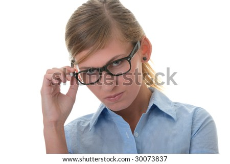 Portrait of a thoughtful young woman in blue shirt and glasses (student, secretary or business woman)