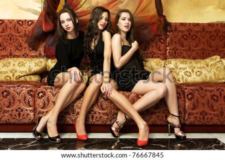 Portrait of a three beautiful women in oriental interior - stock photo