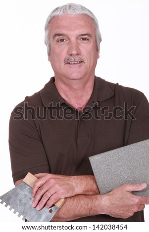 Portrait of a tiler - stock photo