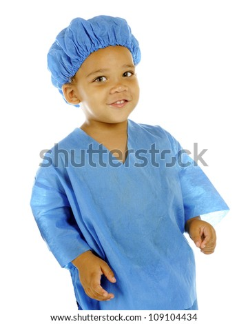Portrait of a tiny ER worker in blue scrubs.  Taken on a white background.