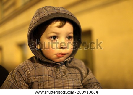 Portrait of a tired boy at night - stock photo