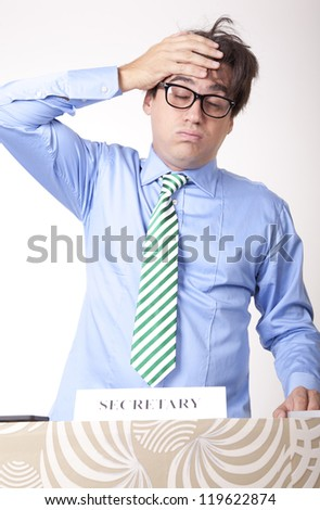 Portrait of a tired businessman at the secretary desk. - stock photo