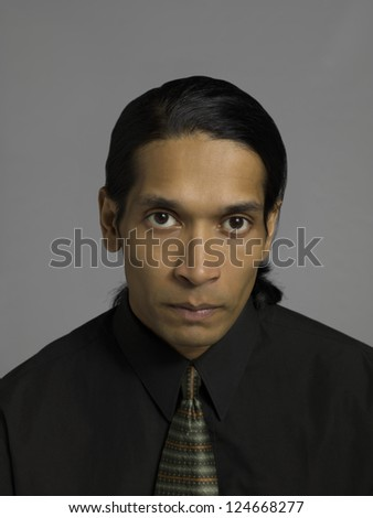 Portrait of a tired businessman isolated over the gray background