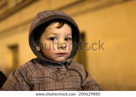 Portrait of a tired child at night - stock photo
