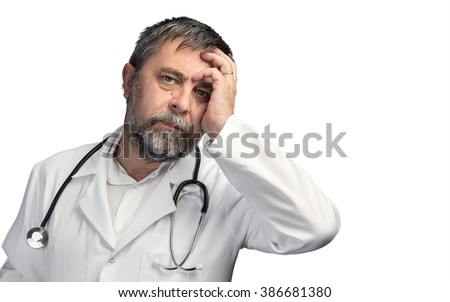 Portrait of a tired doctor with hand near his head isolated on white background with copyspace