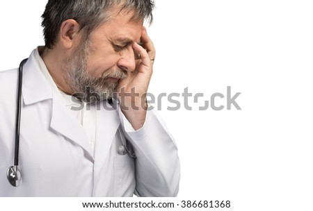 Portrait of a tired doctor with hand near his head, looking totally stressed out. Isolated on white background with copyspace