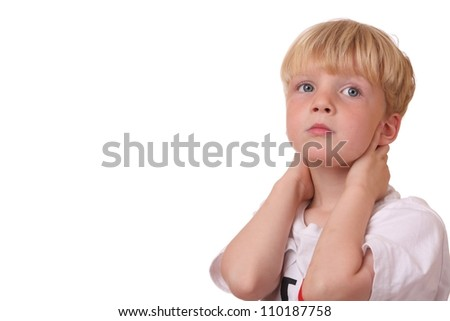 Portrait of a tired looking boy on white background - stock photo