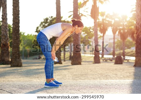 Portrait of a tired woman resting after workout exercise - stock photo