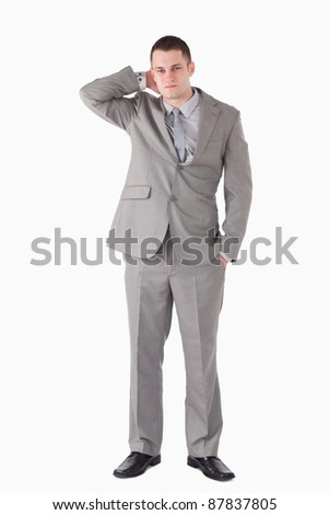 Portrait of a tired young businessman against a white background - stock photo