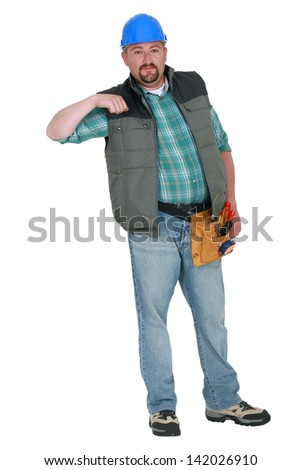 Portrait of a tradesman holding his arm up - stock photo