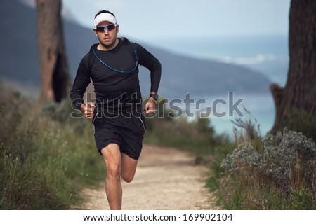 portrait of a trail runner exercising for fitness - stock photo
