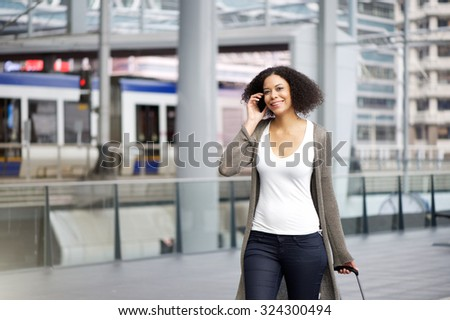 Portrait of a traveling woman traveling with mobile phone - stock photo