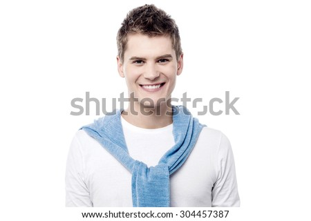 Portrait of a trendy handsome male posing over white