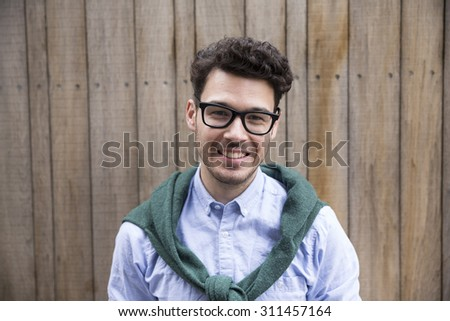Portrait of a trendy urban Caucasian man. Urban man in city. - stock photo