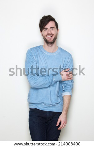 Portrait of a trendy young man smiling on white background