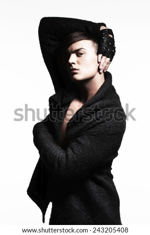 Portrait of a Trendy Young Man with Gloves - stock photo