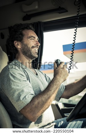 Portrait of a truck driver using CB radio - stock photo