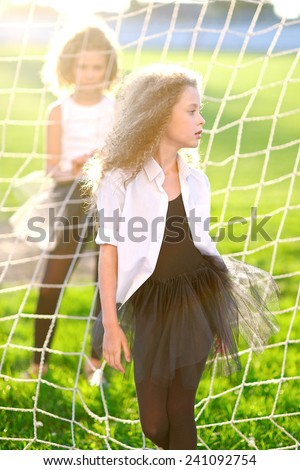 portrait of a two beautiful fashion little girl - stock photo