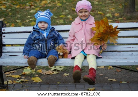 portrait of a two kids at bench - stock photo