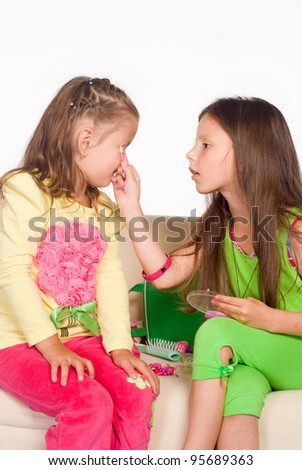 portrait of a two little girls on sofa