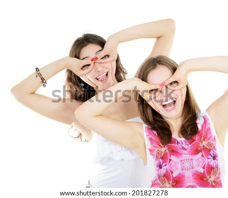 Portrait of a two teen girls have fun and make faces looking and searching something, isolated on white  - stock photo