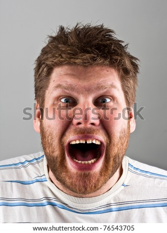 Portrait of a ugly angry screaming man - stock photo