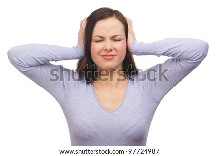 Portrait of a unhappy young woman covering her ears. Isolated on white background