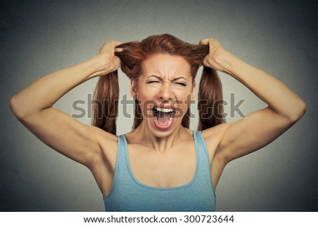 Portrait of a very angry woman screaming acting out  - stock photo