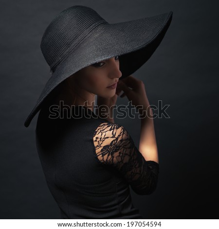 Portrait of a very beautiful girl in black dress and hat. Photo in color style instagram filters  - stock photo