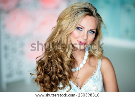 Portrait of a very beautiful sexy sensual girl with gorgeous curly blonde hair, blue eyes, close-up - stock photo