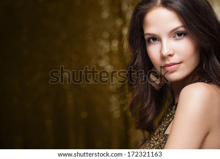 Portrait of a very fashionable, cool and elegant festive young woman.